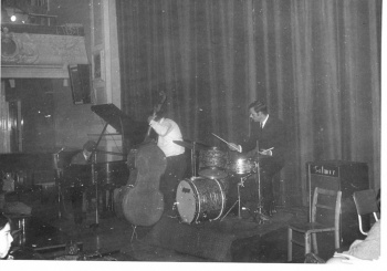 Pianist, bassist, and drummer onstage (3)